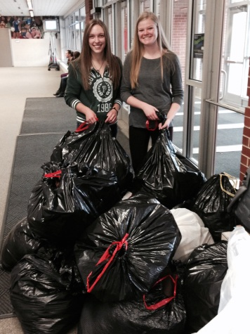 Seniors Madi Sogge and Brenna Steichen helping with the coat drive.