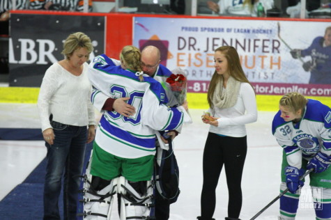 Junior, Katelyn Vrieze, hugging Steve Plashko.
