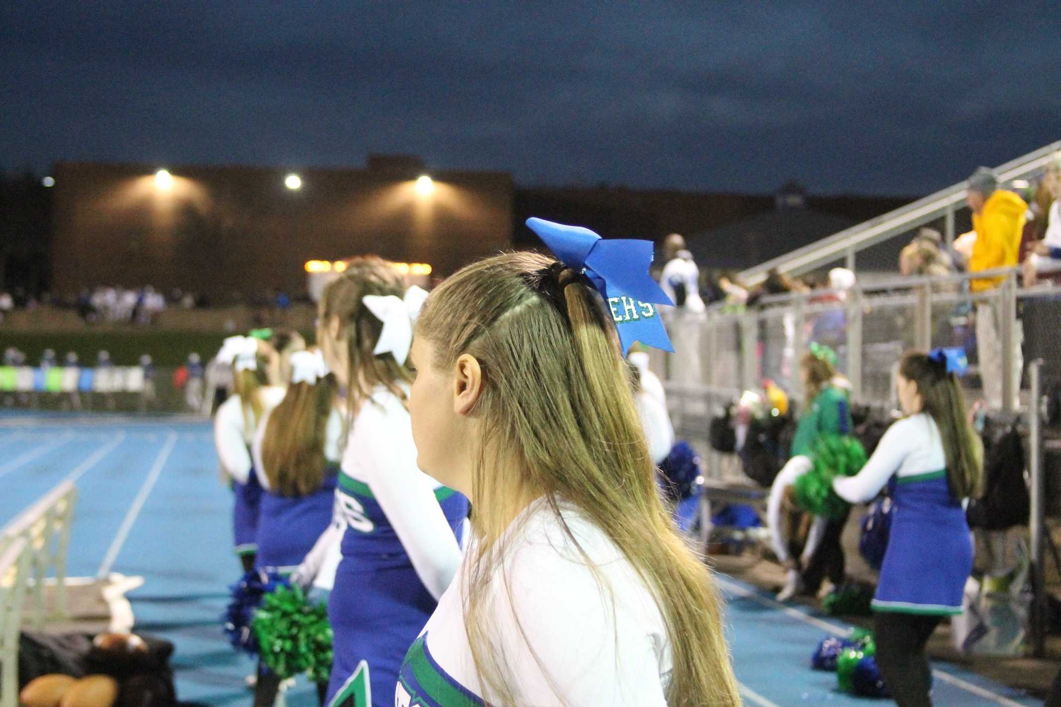 Cheerleaders attentively watch the game